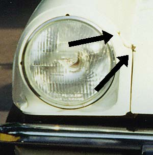 Photo of Triumph Spitfire showing rust points around the headlight